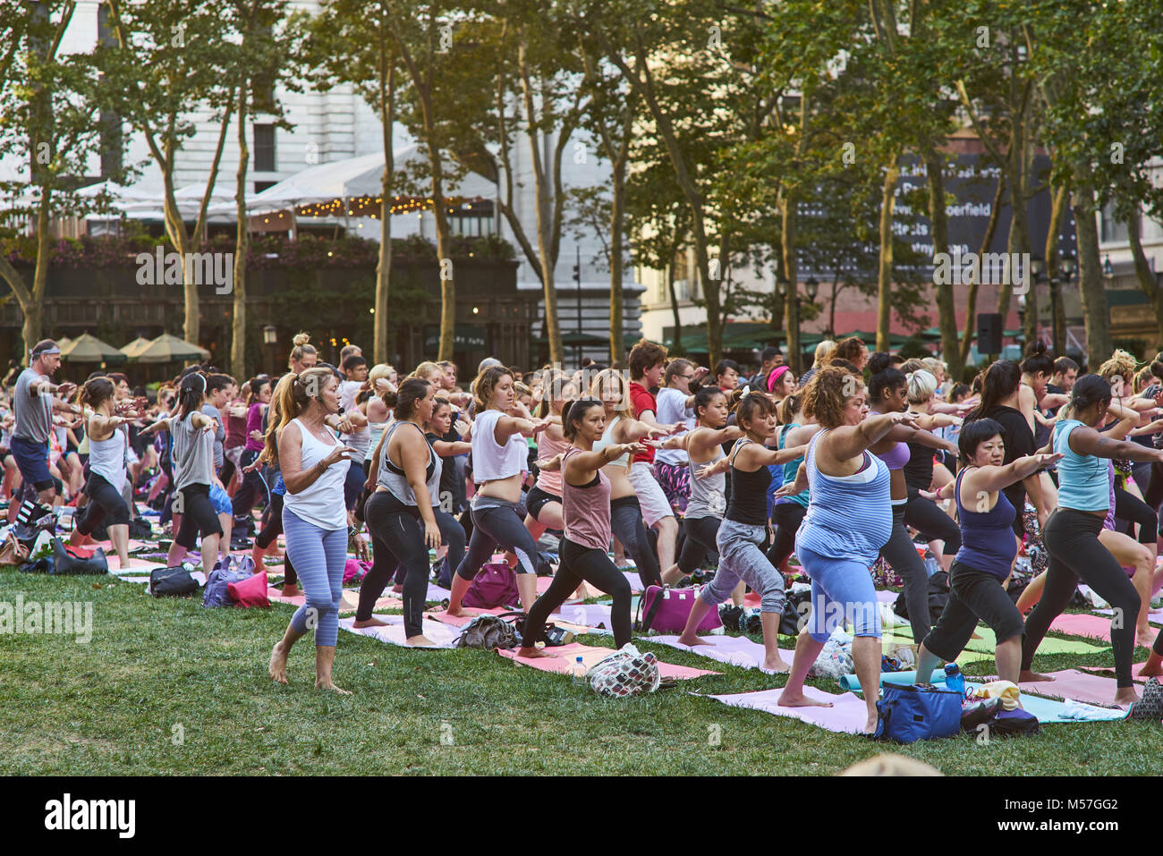 Yoga classes presented by sportswear brand Athleta, during which instructors from Yoga Journal on the Lawn - Stock Image