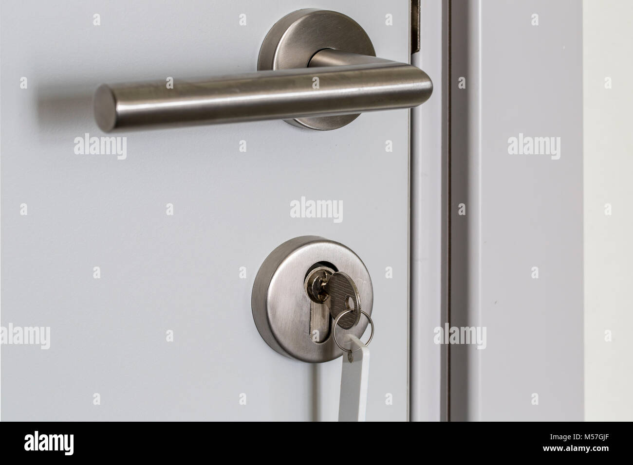 Gentil Key In Keyhole On Door   Stock Image