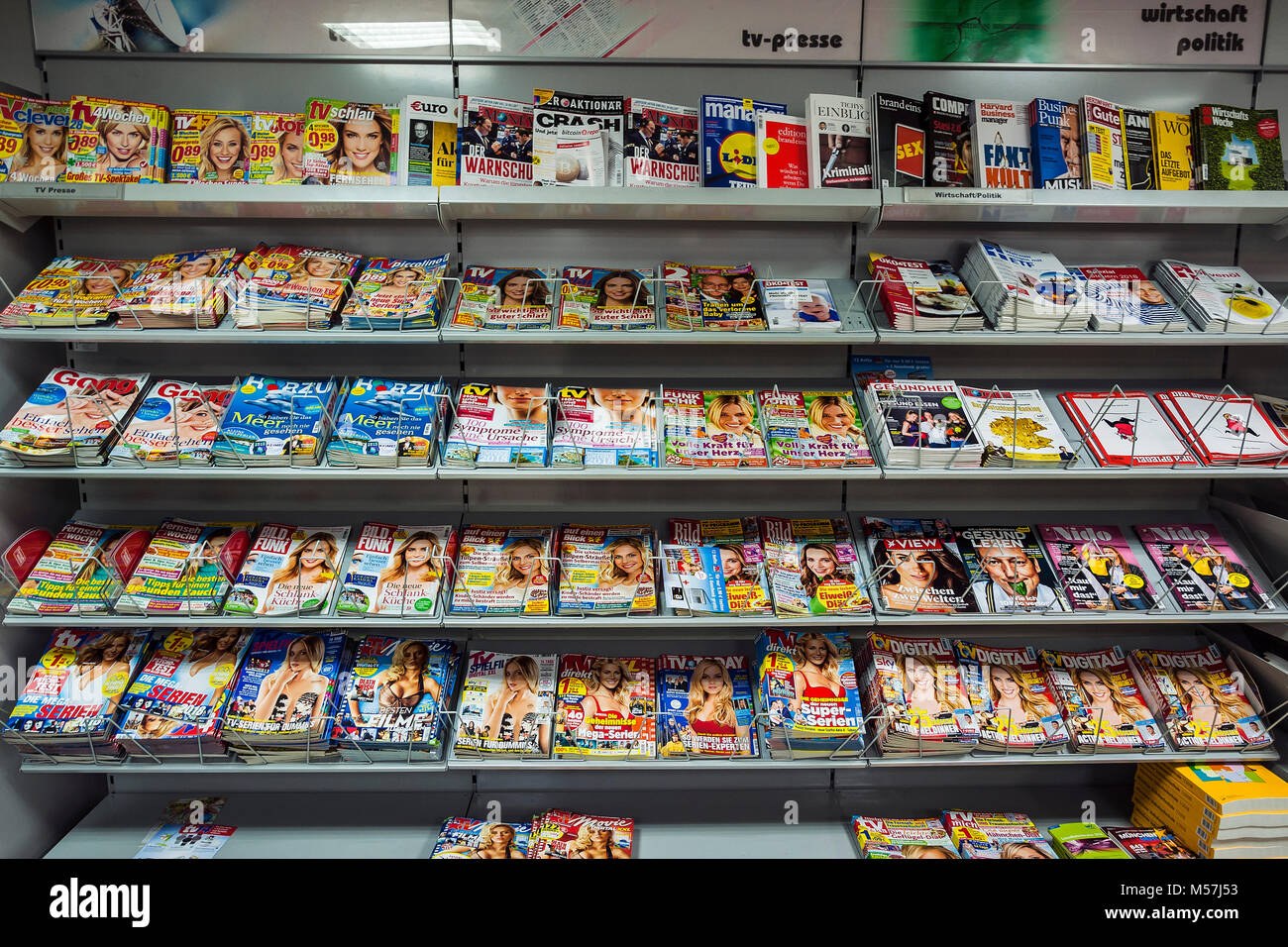 Shelf with magazines in a supermarket,Germany - Stock Image