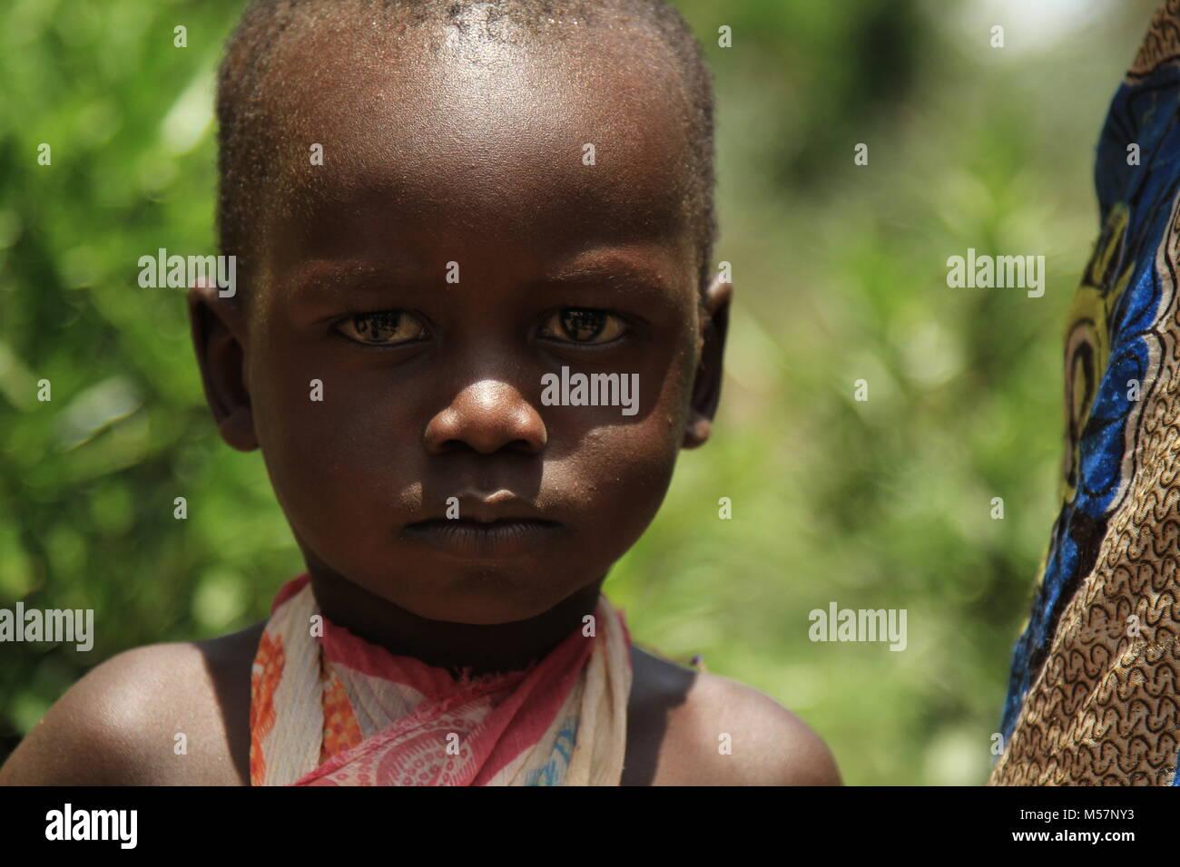 Stoic girl in rural Uganda. - Stock Image
