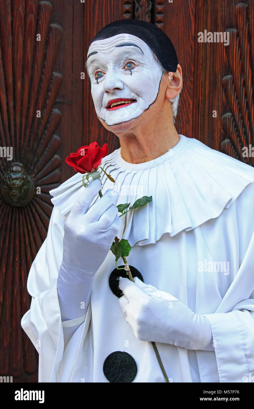 A mime artist holding a rose during the Carnival of Venice (Carnevale di Venezia) in Venice, Italy - Stock Image