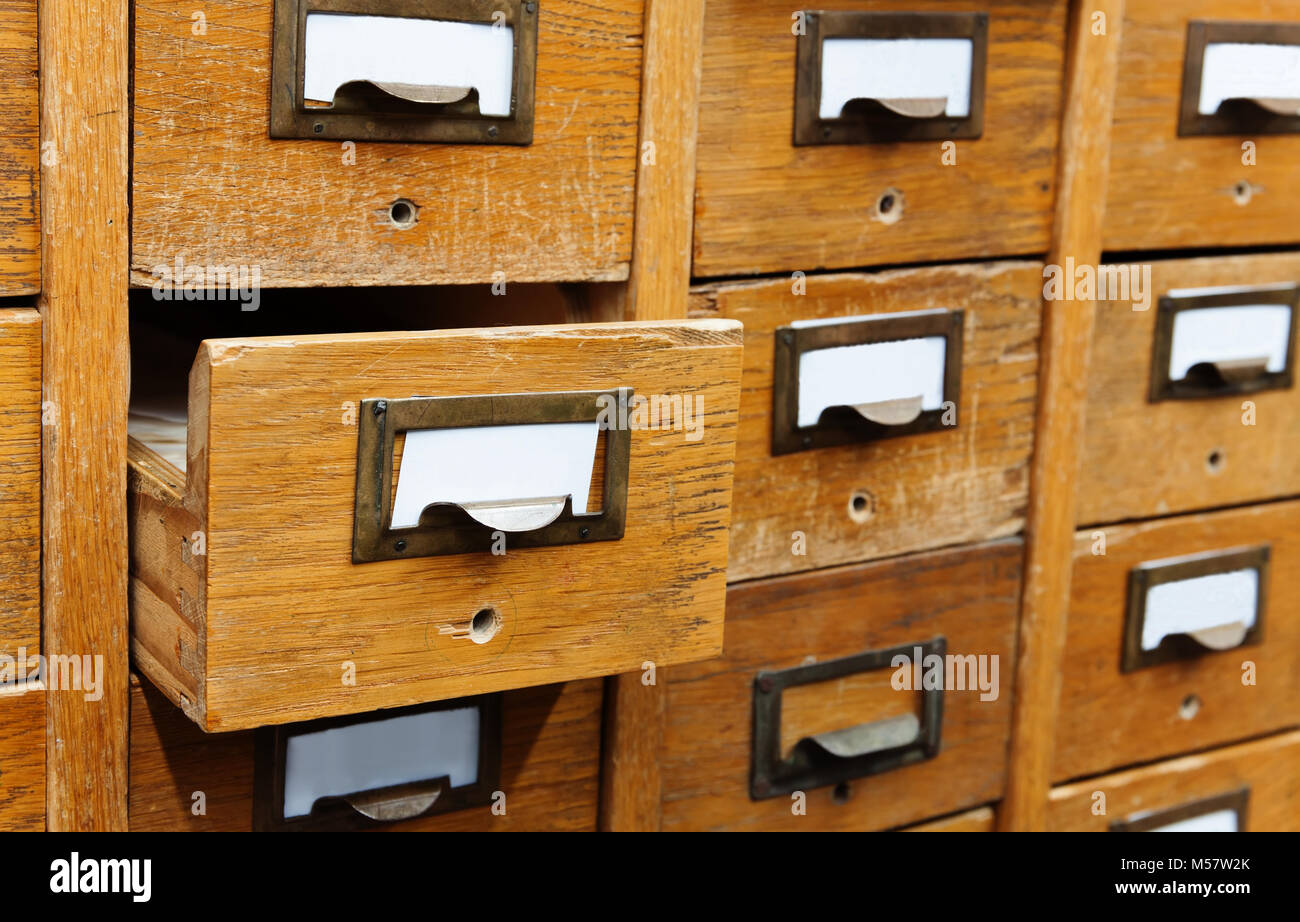 Opened box archive storage, filing cabinet interior. wooden boxes with index cards. library service information - Stock Image