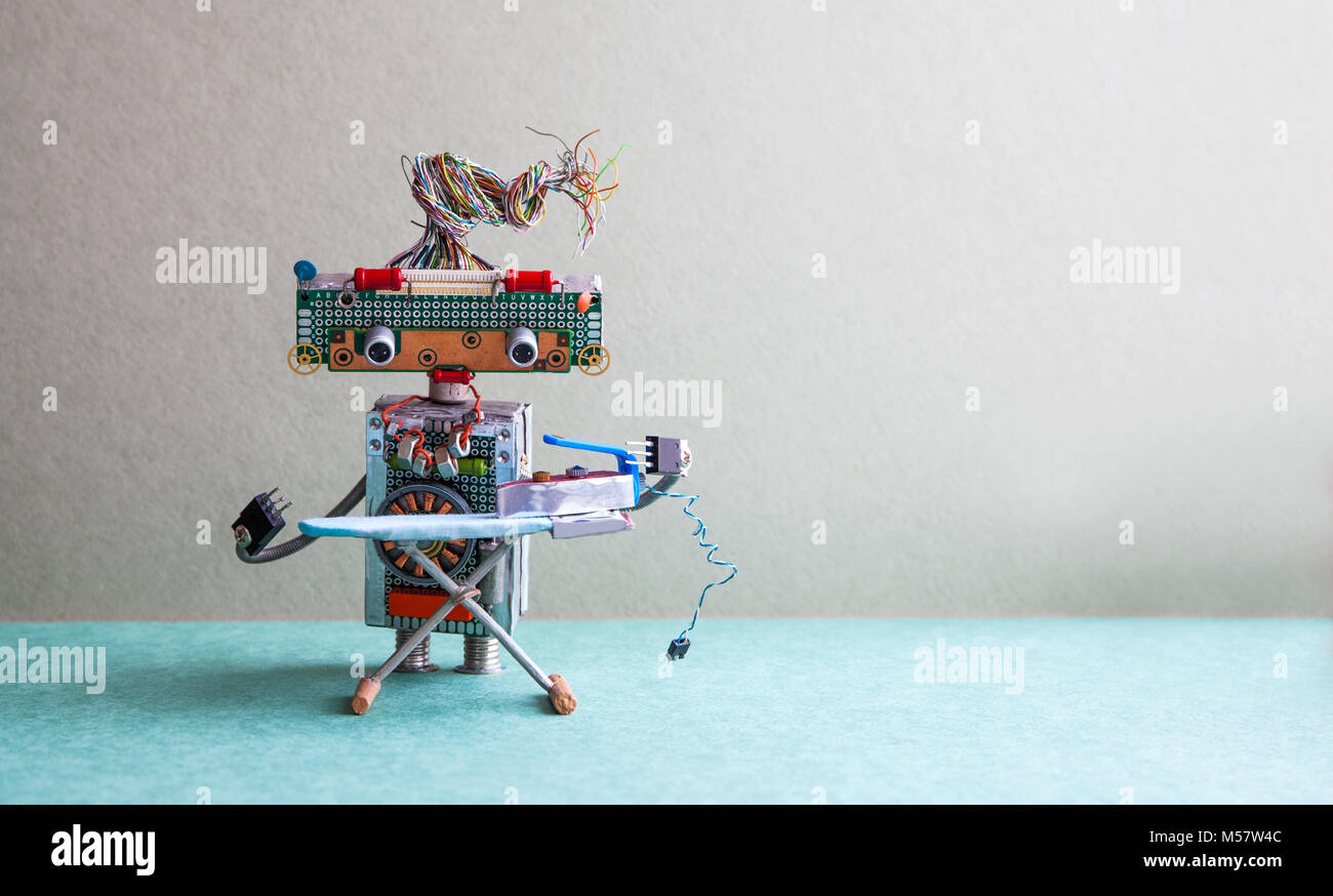 Robot with steam iron on the board. gray wall green floor room interior. Creative design toys housework concept. - Stock Image