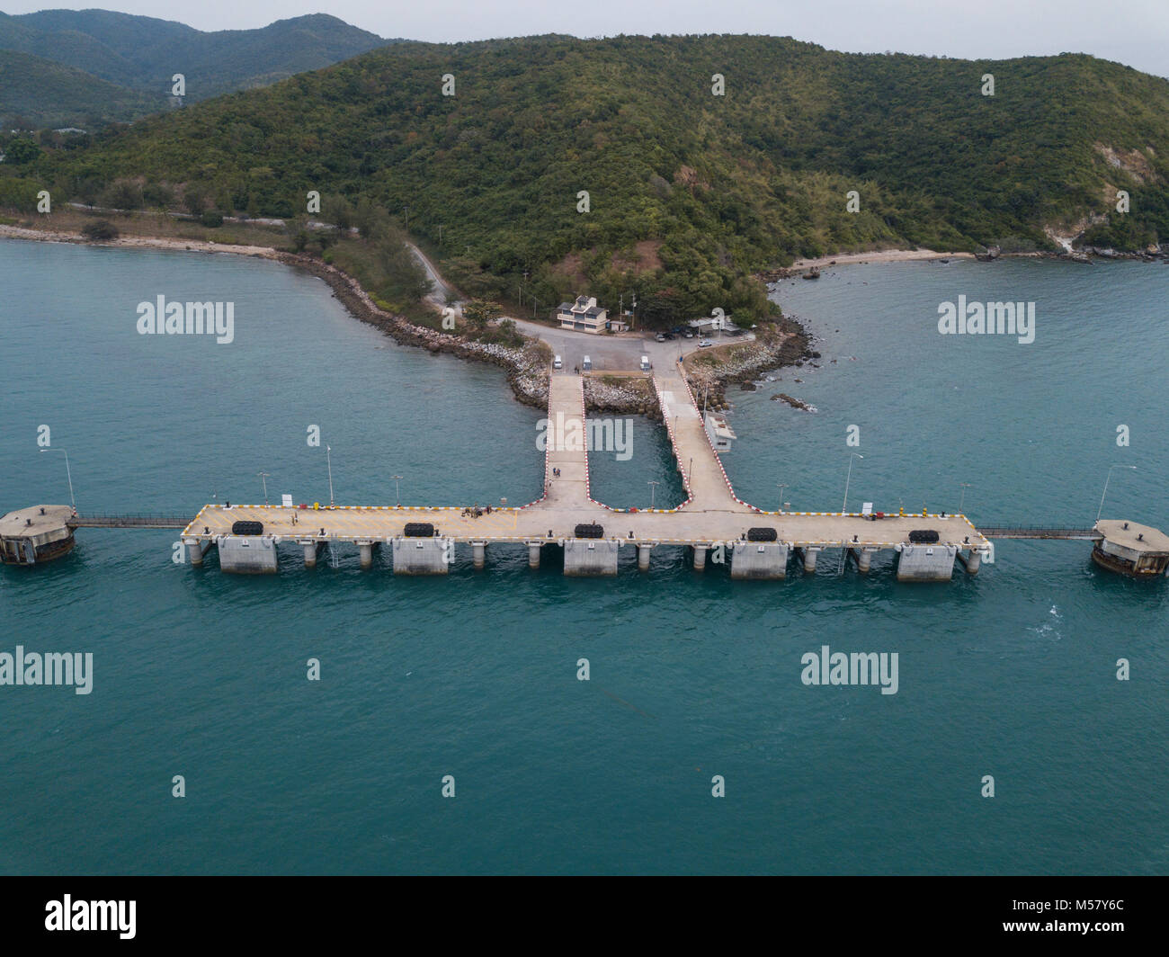 U.S. Navy Sailors assigned to Underwater Construction Team 2, stand on the Thung Prong Pier in Sattahip, Thailand Stock Photo