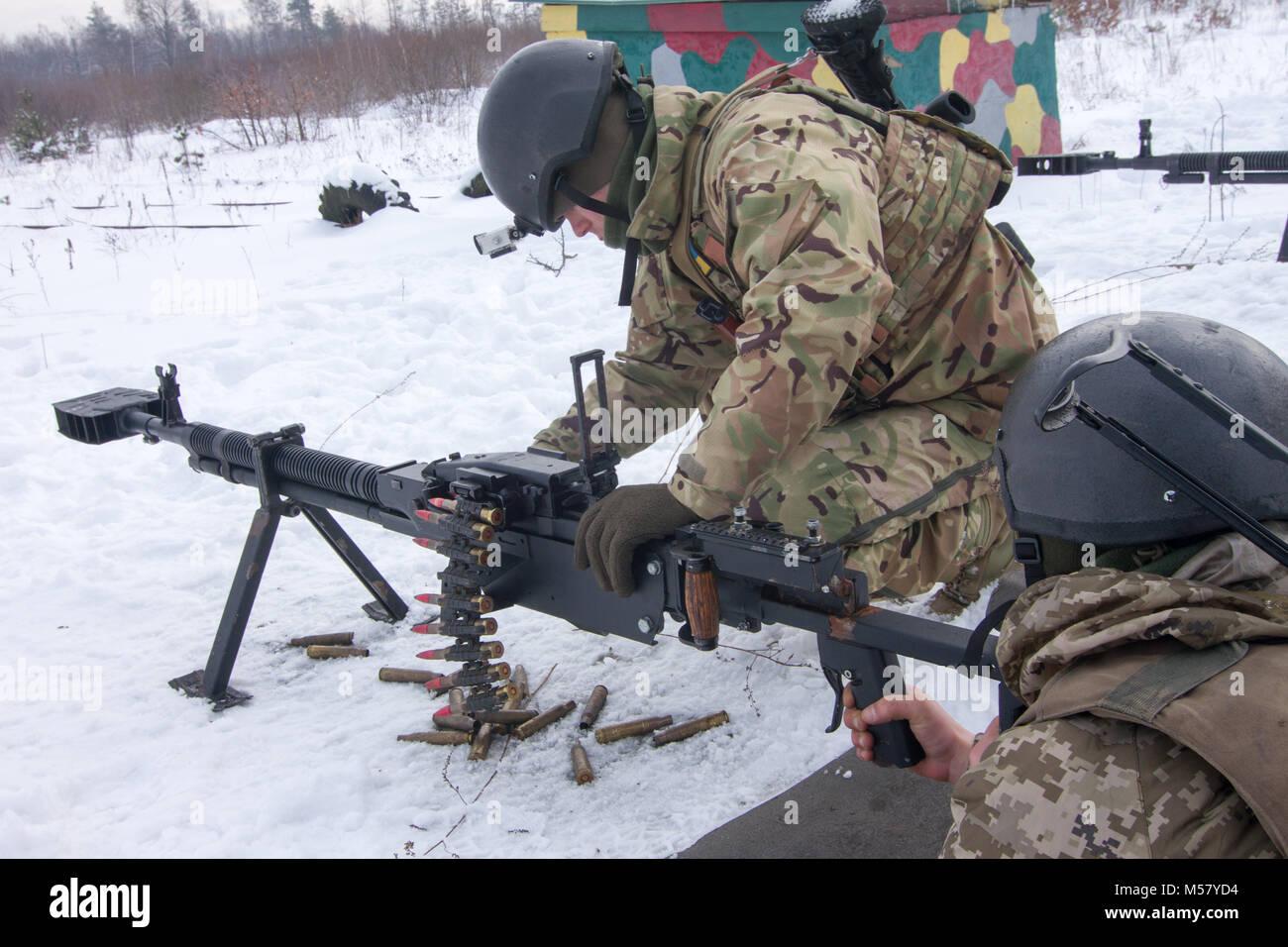 Yavoriv, Ukraine -- Ukrainian Soldiers assigned to 3rd Battalion, 14th Mechanized Brigade operate a DshK machine Stock Photo