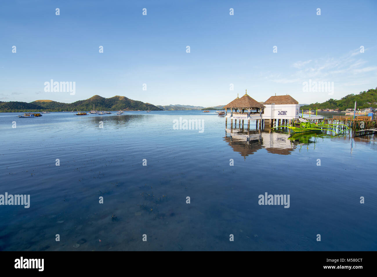 Still sea of Coron Harbor off of Palawan Island, Philippines. - Stock Image