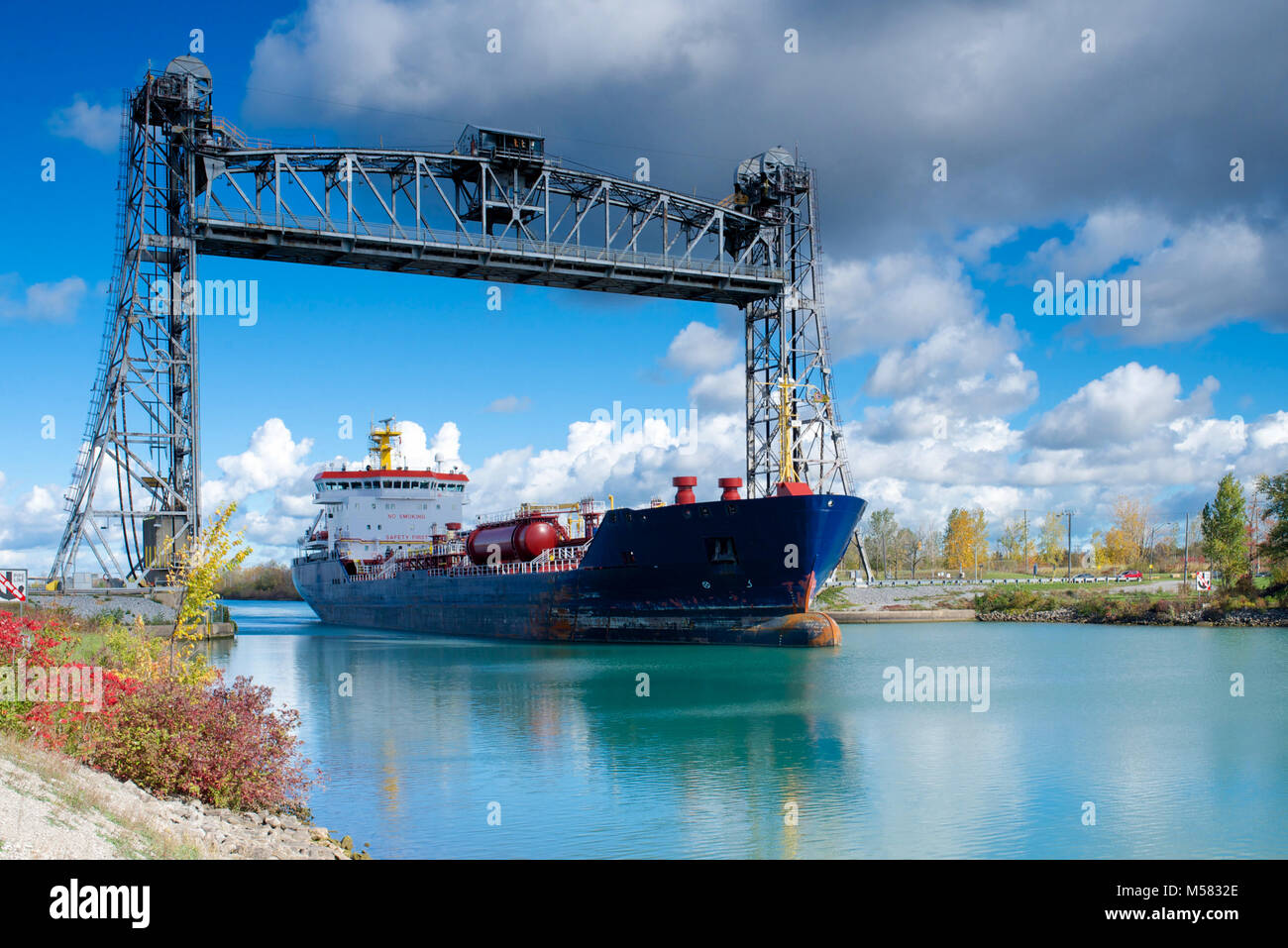 A chemical tanker passing through the Welland Canal, Ontario, Canada - Stock Image