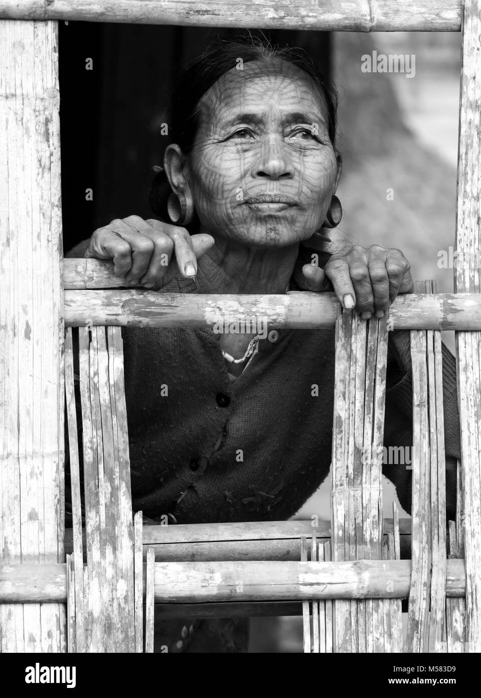 An elderly tattooed Chin woman, in a village upriver from Mrauk U town. Chin state, Myanmar - Stock Image