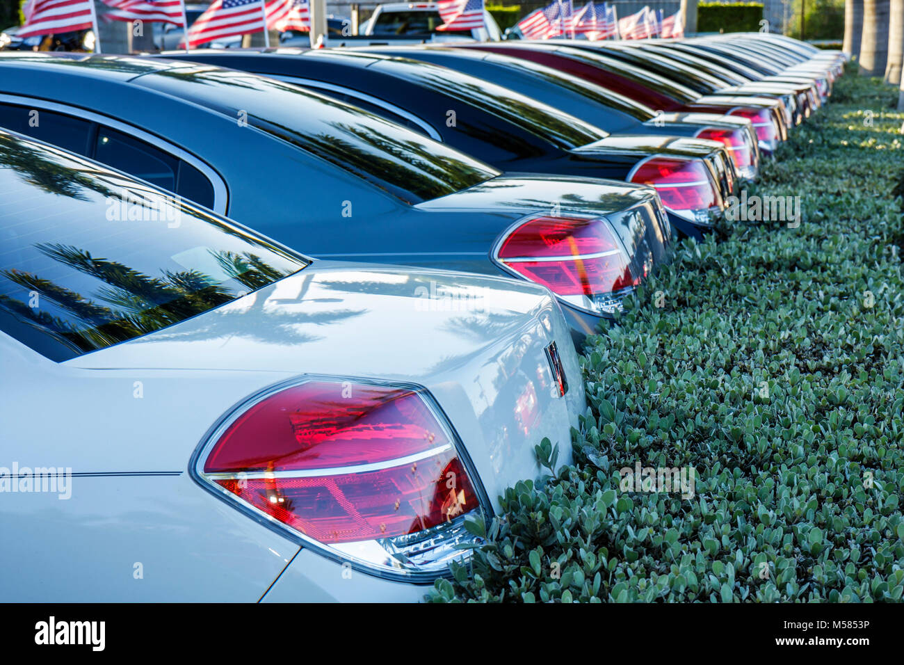 Miami GM General Motors Saturn Aura new car dealership lot automobile tail lights design - Stock Image