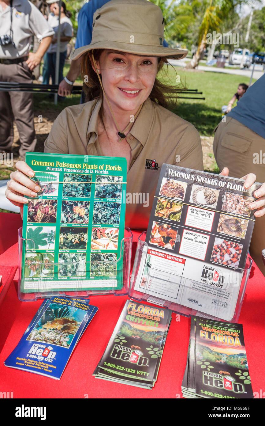 Miami Metrozoo Nonnative Pet Amnesty Day woman poison control education Venomous Snakes Common Poisonous Plants - Stock Image
