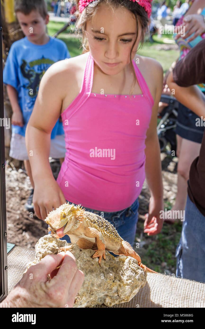 Miami Metrozoo Nonnative Pet Amnesty Day bearded dragon lizard reptile Hispanic girl - Stock Image