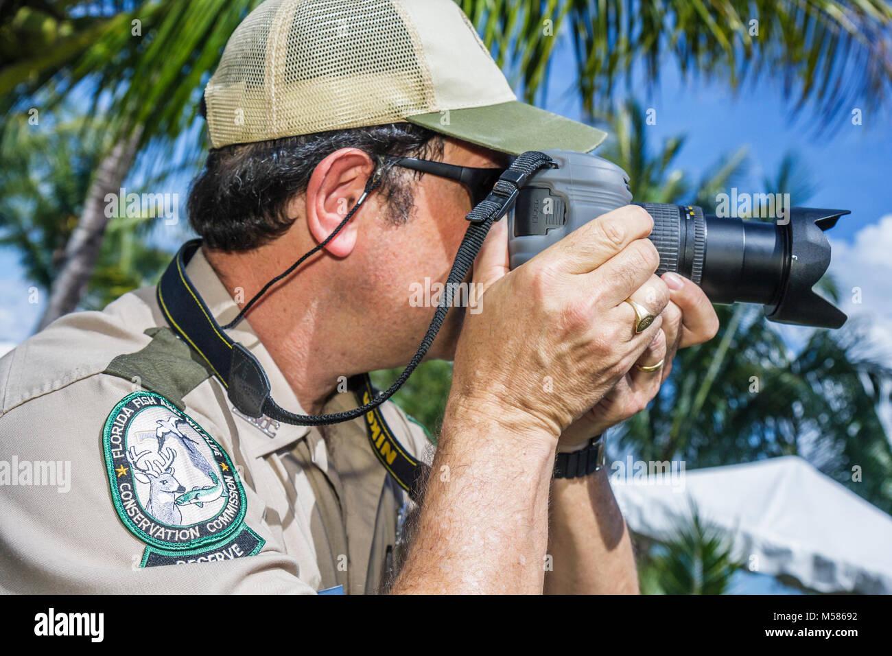 Miami Metrozoo Nonnative Pet Amnesty Day man camera - Stock Image