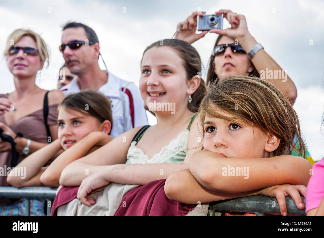 Virginia Key Beach Park Grand Re Opening Family Fest Day historic audience Hispanic girl watches performance - Stock Image