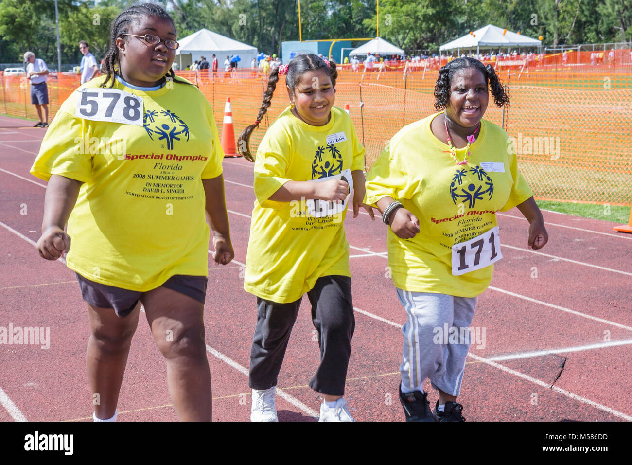 Special Olympics mentally physically disabled competition volunteers  student sport Black teen girls race track effort