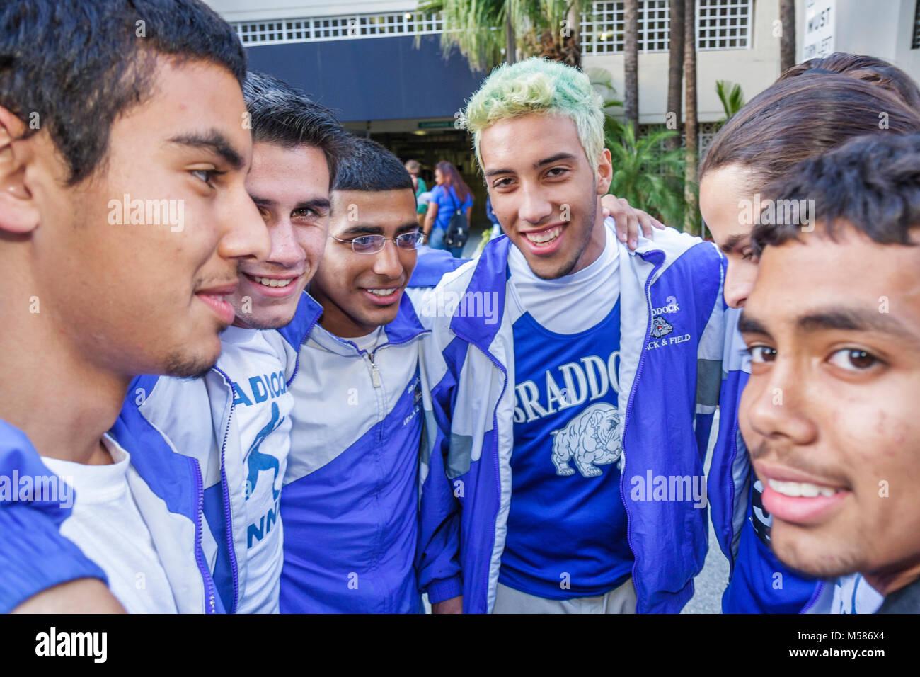 Carnaval 8K Run preparation community event student Braddock High School track team members teen boys - Stock Image