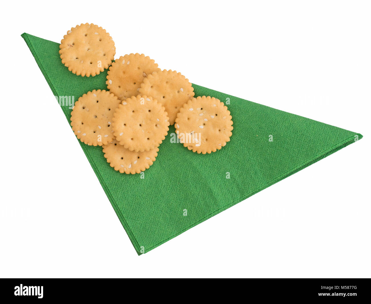 Gluten free cracker biscuits isolated on green paper serviette. - Stock Image