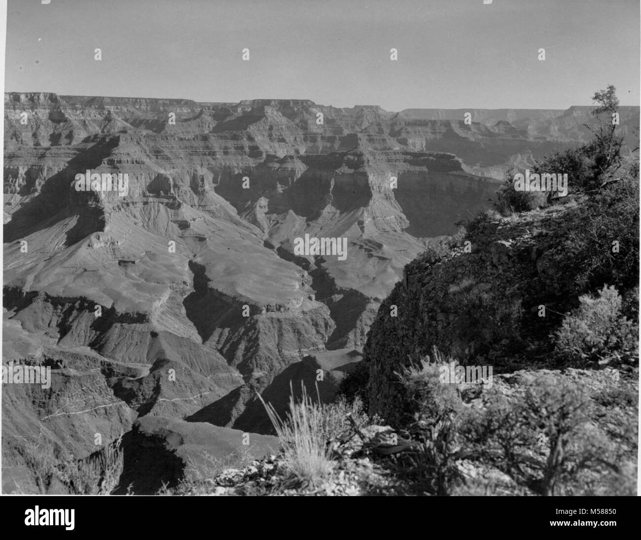 Grand Canyon Historic. LOOKING EAST FROM HAVASUPAI POINT.  NOTE GRANITIC INTRUSION SIN INNER CANYON WALL FORMATION. - Stock Image