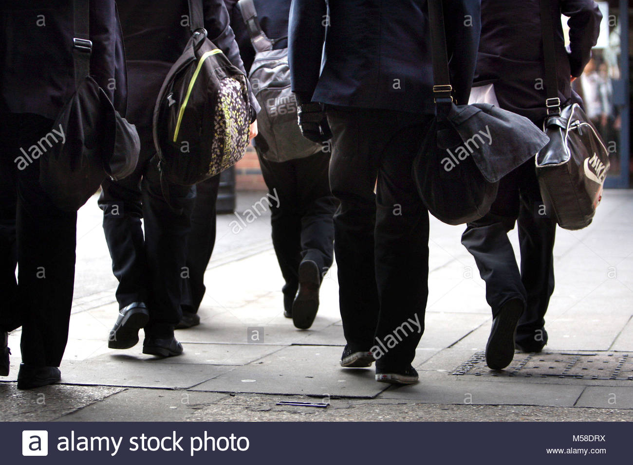 File photo dated 26/01/12 of school pupils, as some GCSE students are to test whether starting school at 10am could - Stock Image