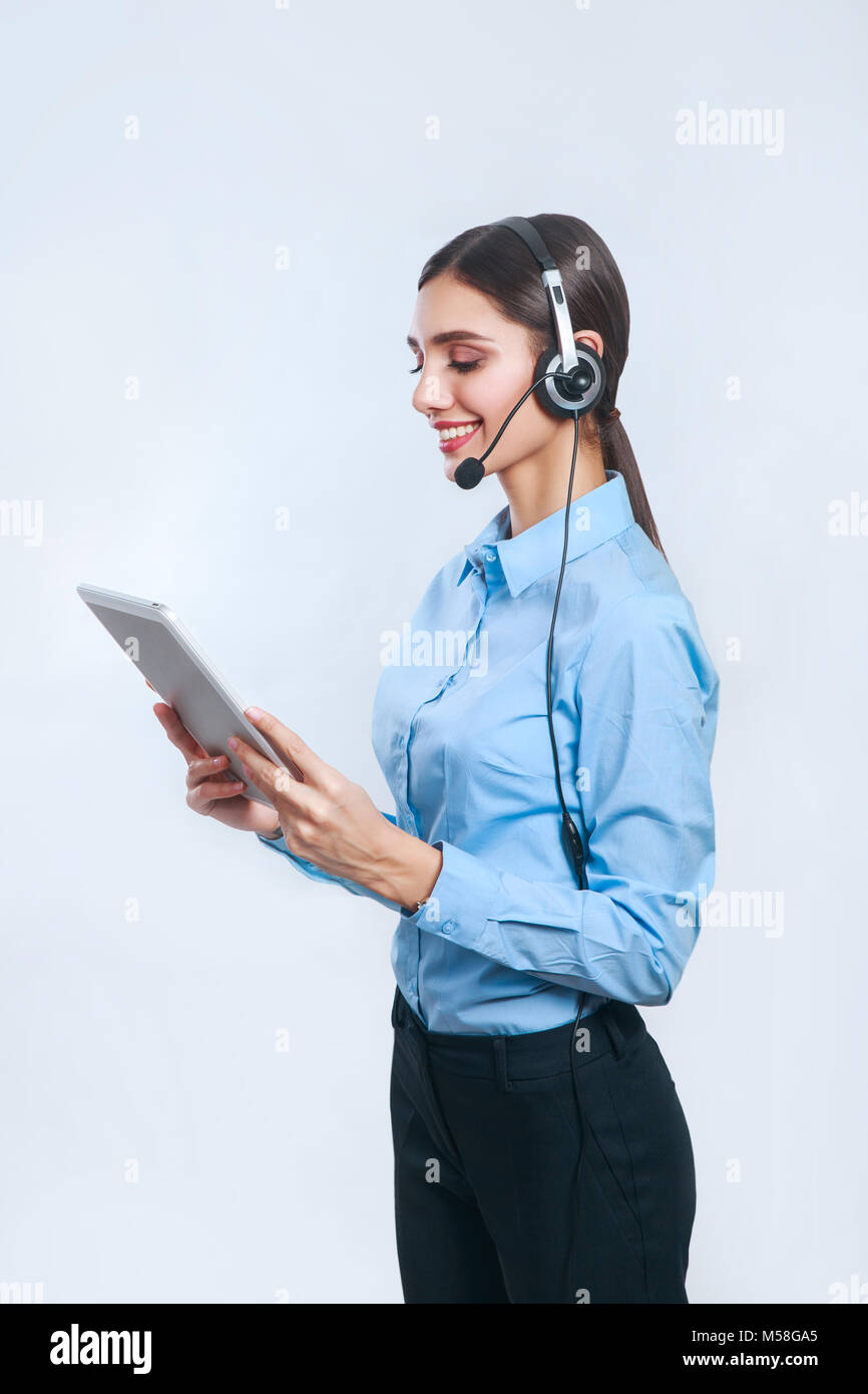 Female customer support operator with tablet. Call center operator Stock Photo