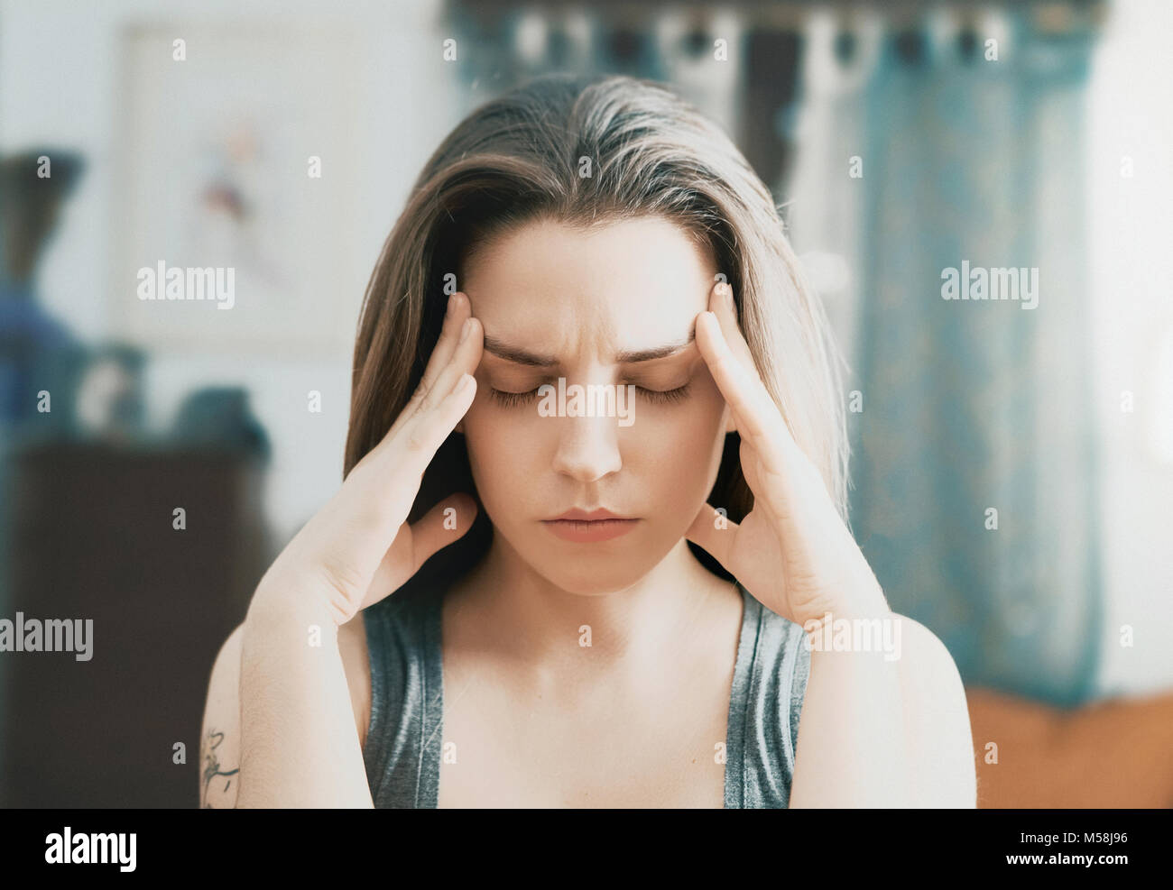 Woman with headache, stress and pain, care - Stock Image
