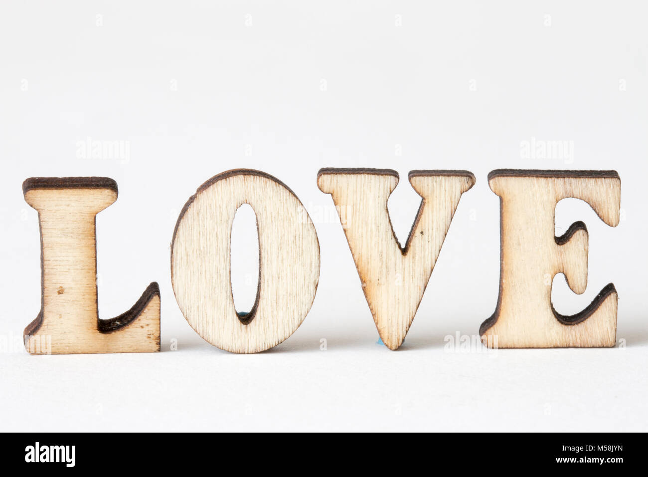 love wood letters love on white background stock image