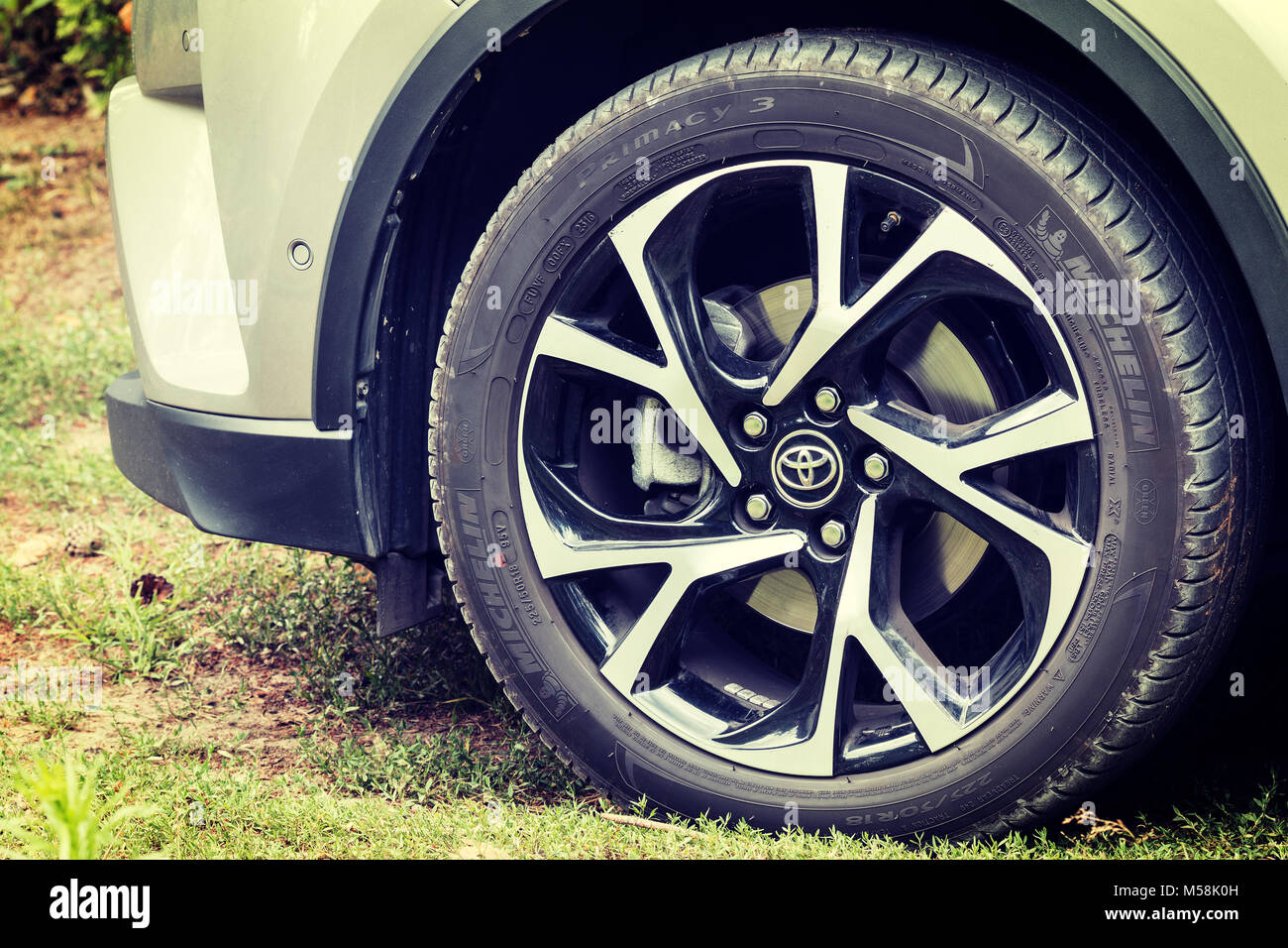 Concept shot of rims and tires of modern crossover car - Toyota CH-R Stock Photo