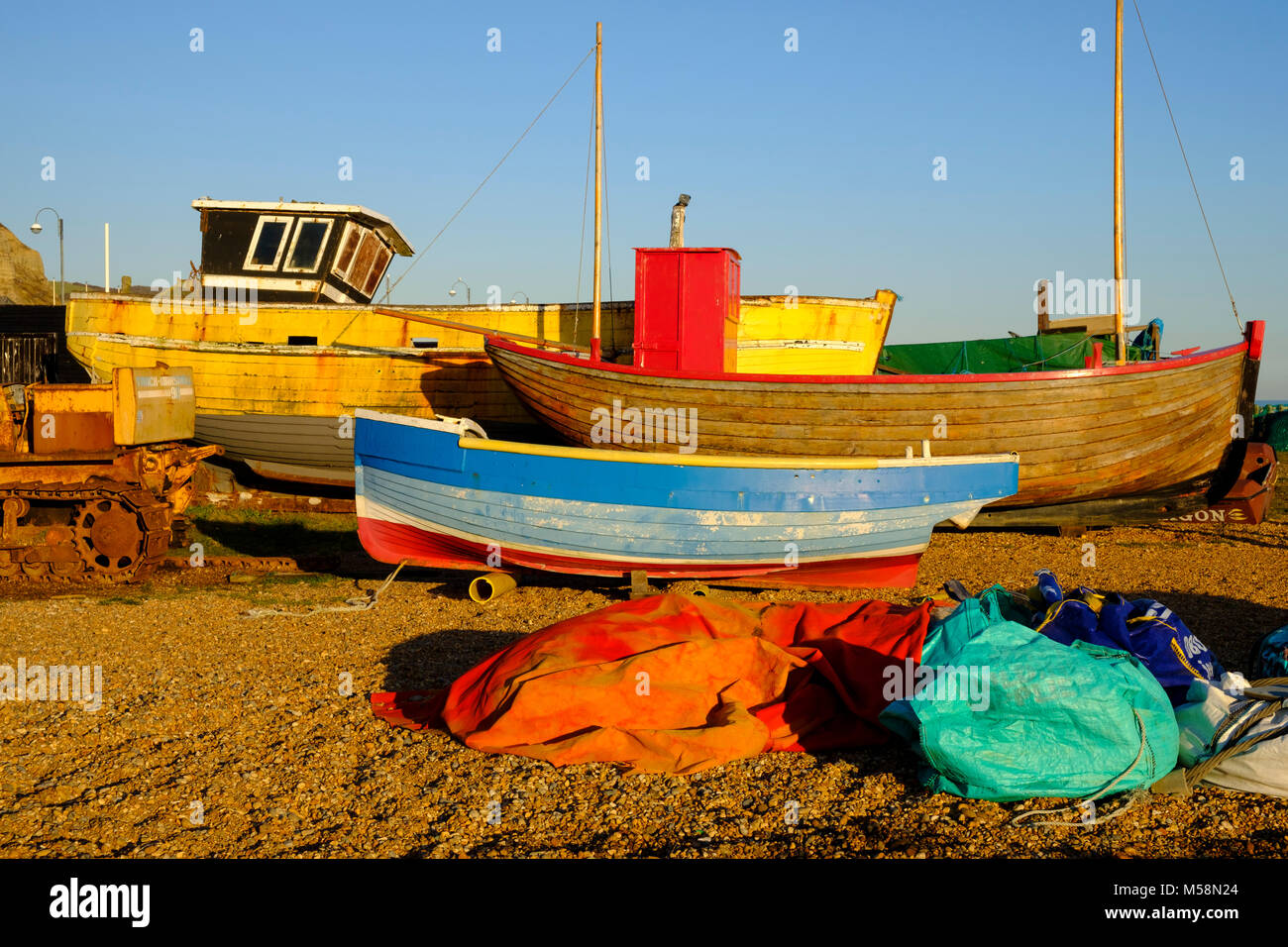 Hastings old traditional clinker built fishing boats awaiting restoration in the Maritime Heritage Quarter at Rock Stock Photo