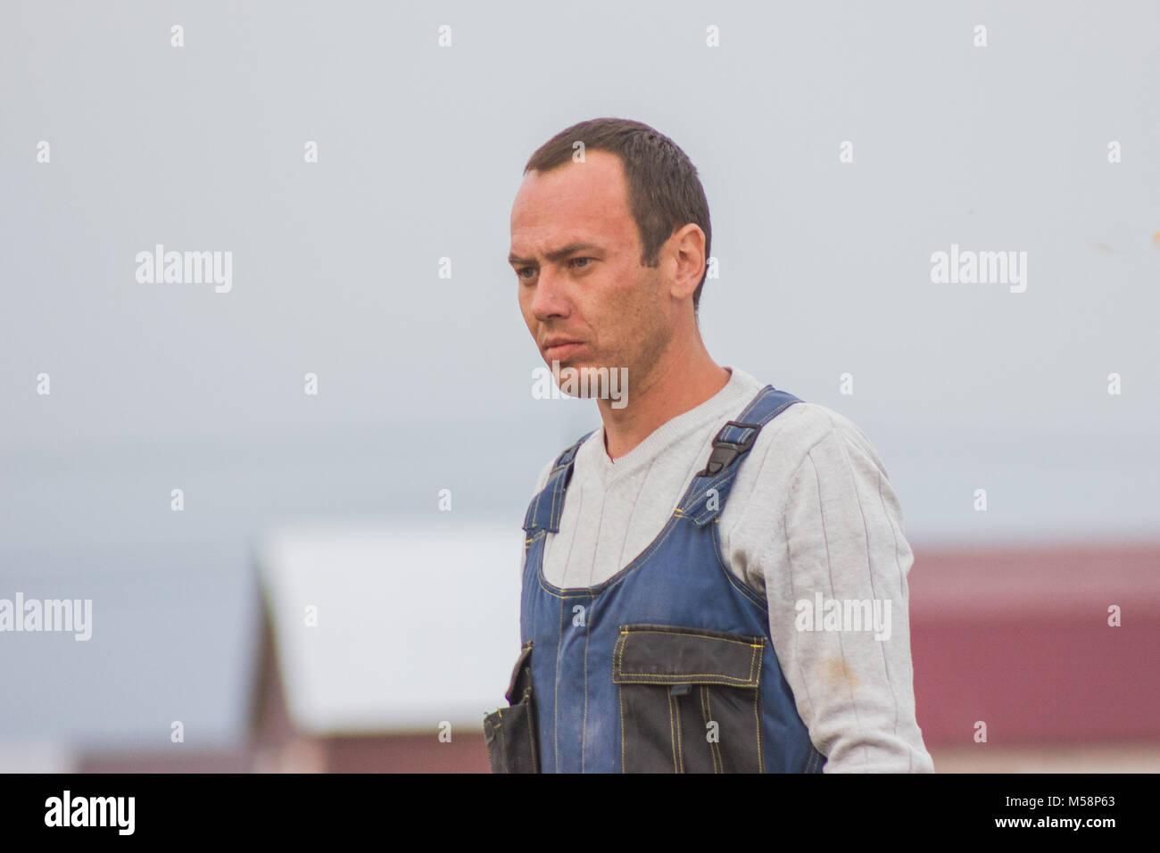 Construction worker at outdoor construction site - Stock Image