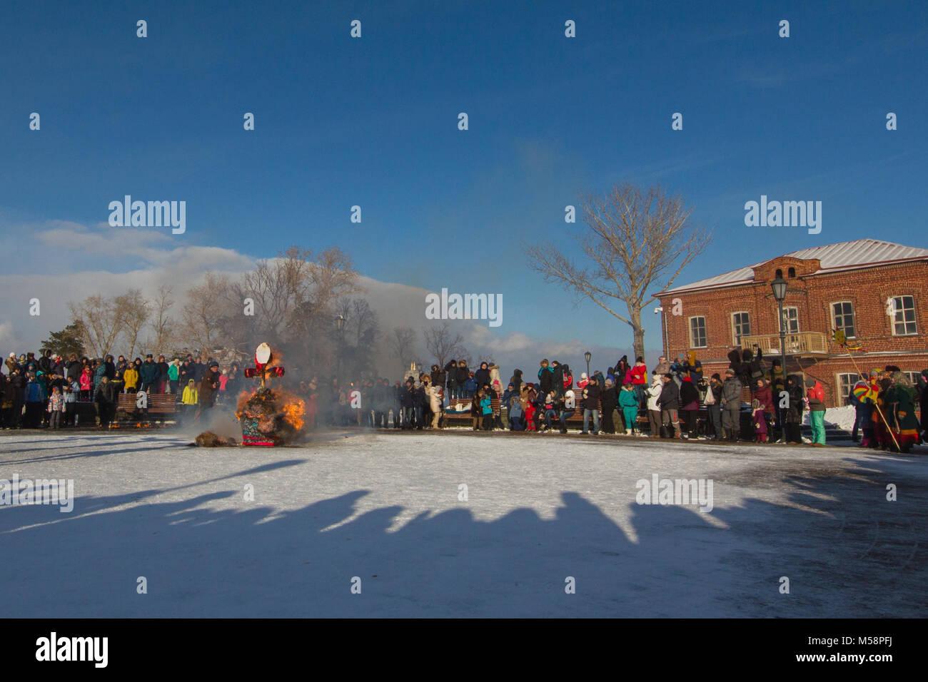 Sviyazhsk, Russia - 26 February 2017: burning of winter's effigy - Maslenitsa Event - crowd looking to pagan - Stock Image