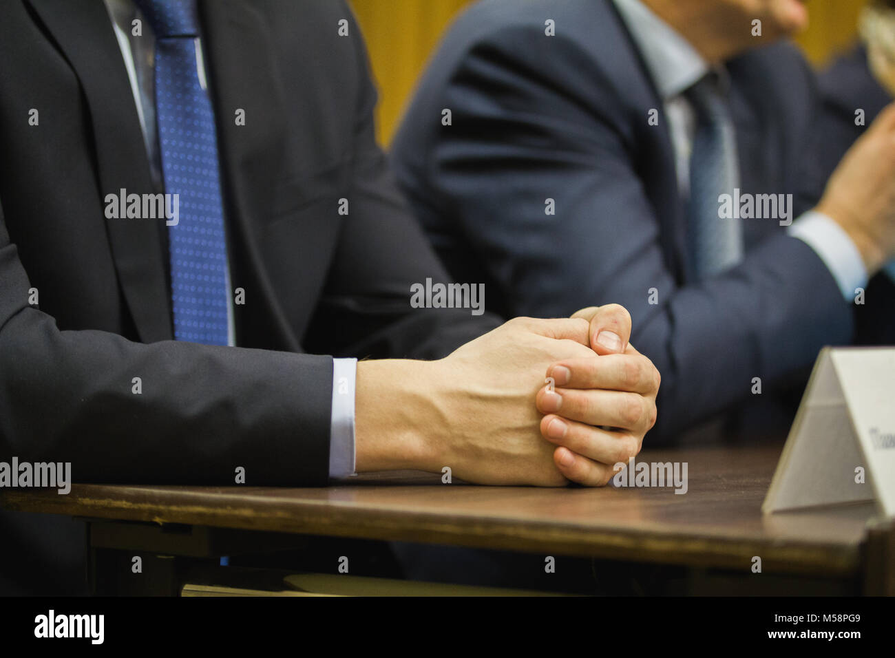 Businessman's hand at conference or meeting, financial concept - Stock Image