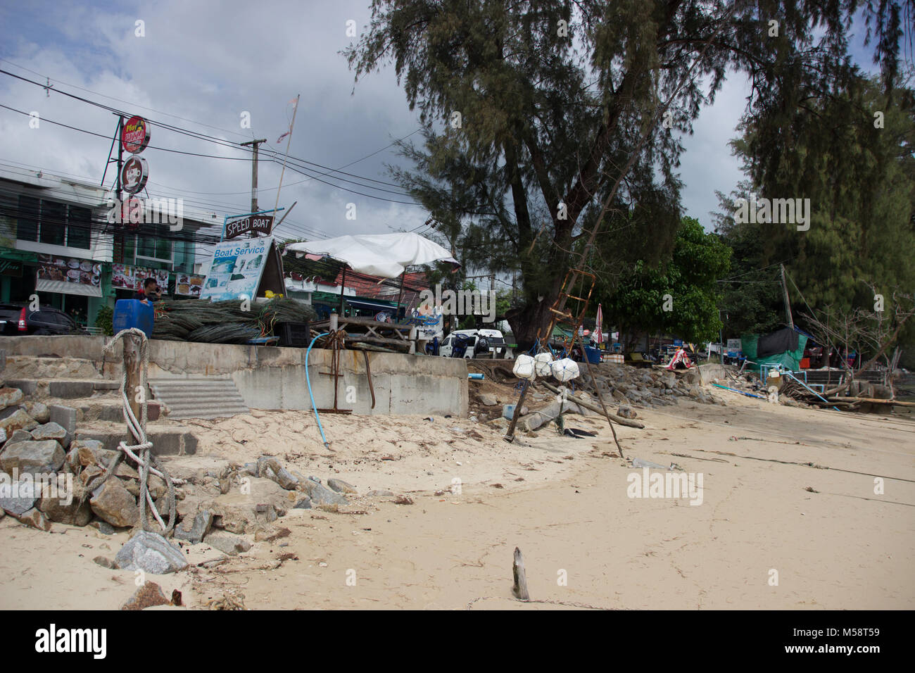 Polluted beaches suffering the effects of mass tourism on Phuket island - Stock Image