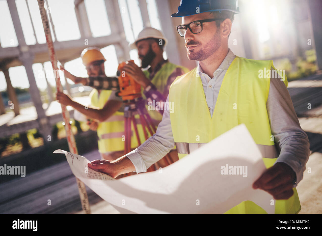 Picture of construction engineer working on building site - Stock Image