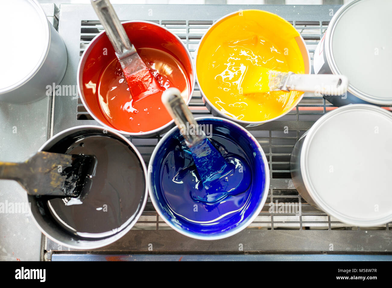 Buckets with CMYK paints - Stock Image
