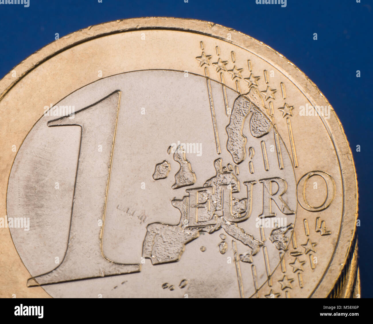 coin one euro on a blue background. Euro money. Closeup. Currency of the European Union. - Stock Image
