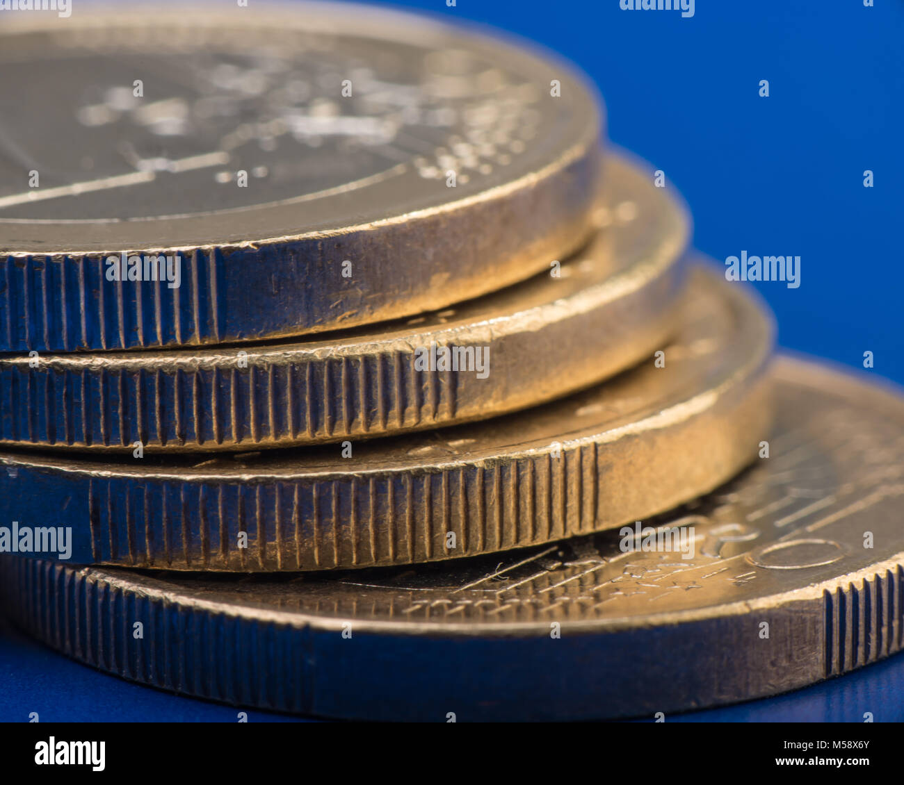 stack of coins is one euro. Euro money. Dark background. Currency of the European Union. - Stock Image