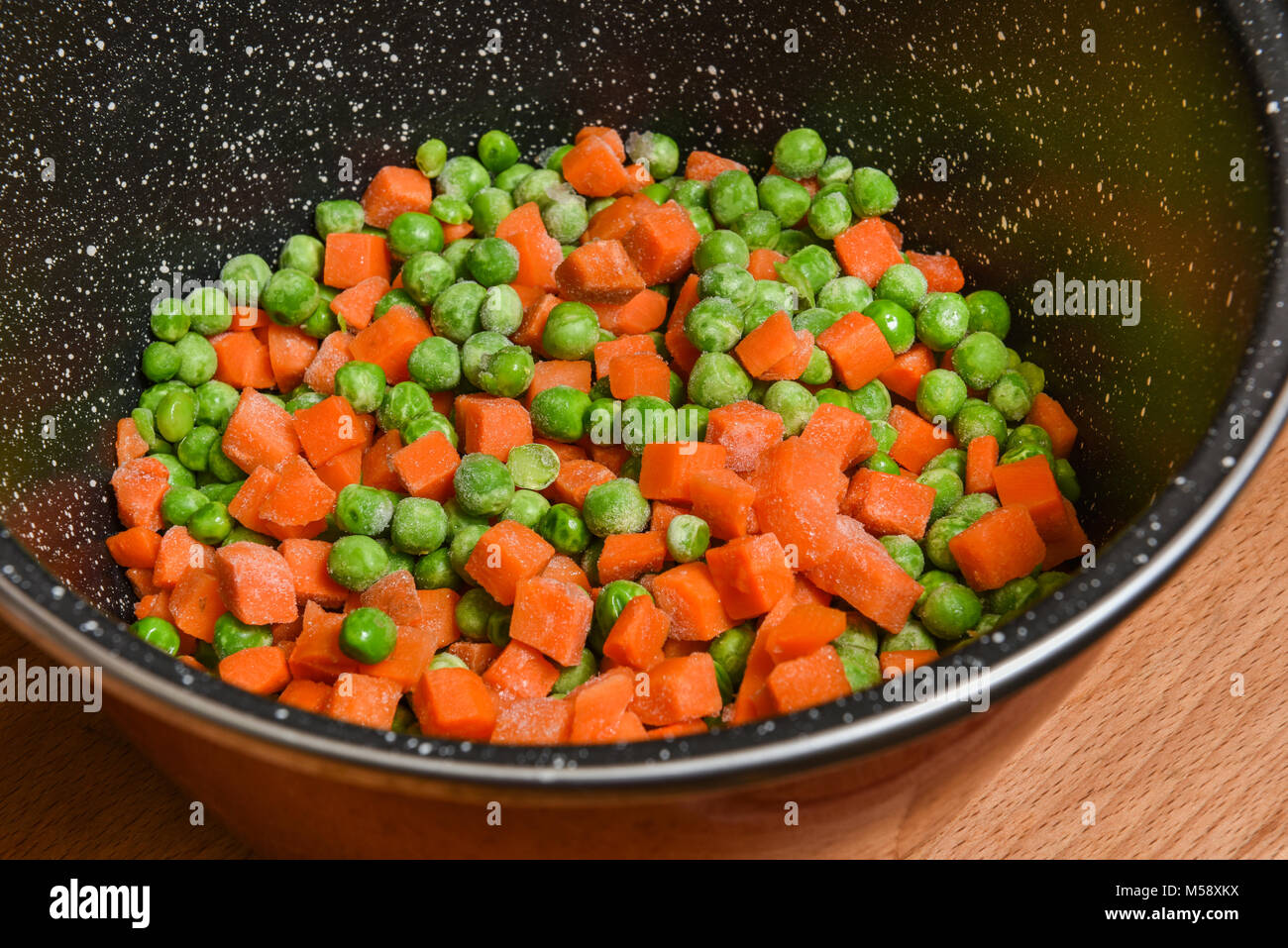 frozen peas and carrots Stock Photo