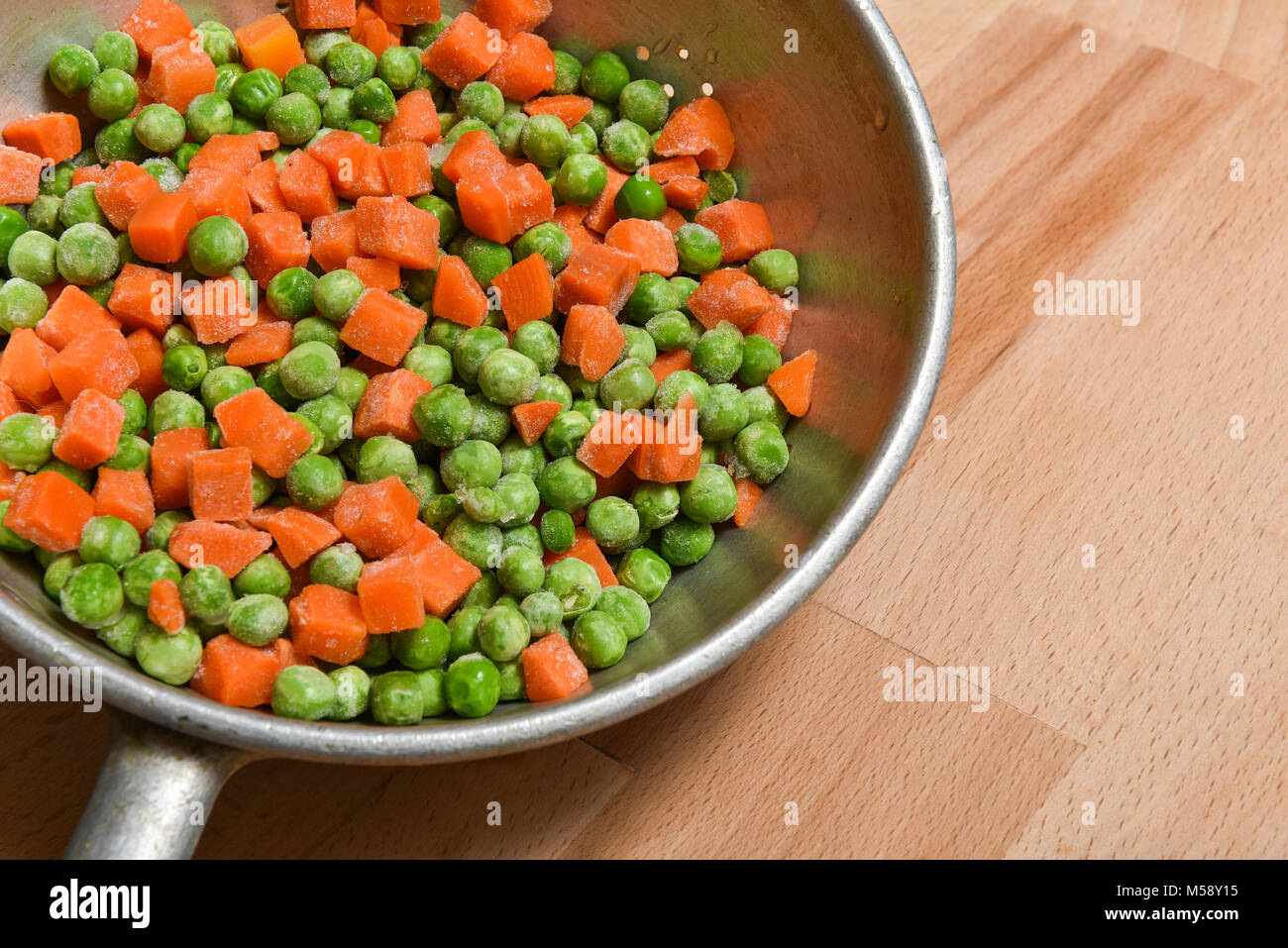 frozen peas and carrots - Stock Image