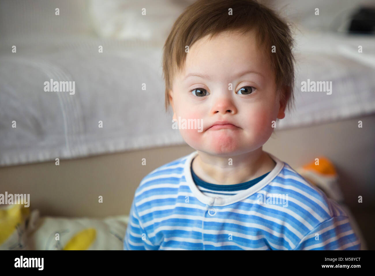 Portrait of cute baby boy with Down syndrome Stock Photo