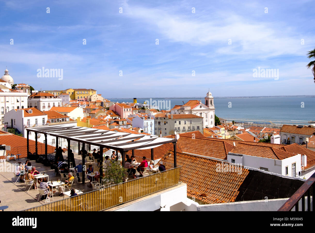 Viewpoint cafe in Alfama overlooking River Tagus in summer , Lisbon, Portugal - Stock Image