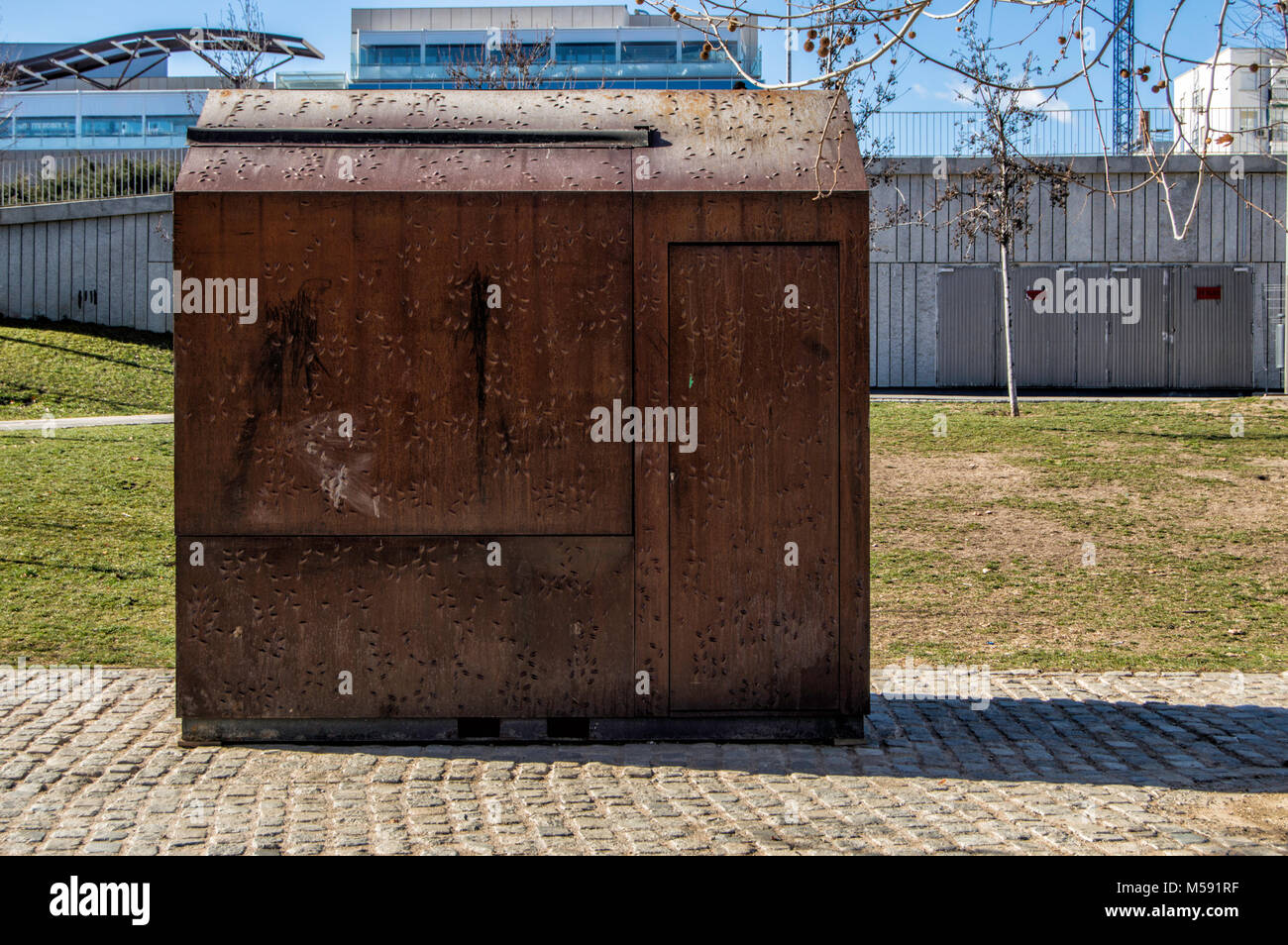 closed iron shed in the Madrid Río park, near the Manzanares River Stock Photo