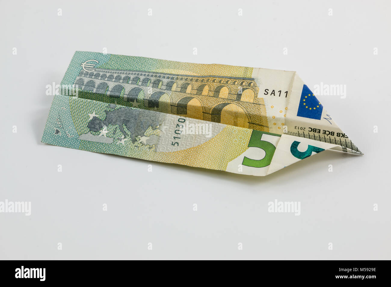 Euro banknotes and white background - Stock Image