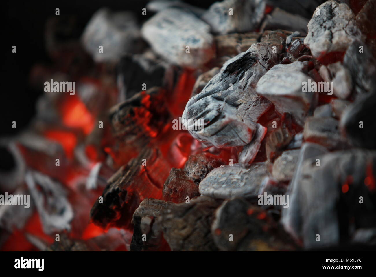 burning charcoal close to abstract  background - Stock Image