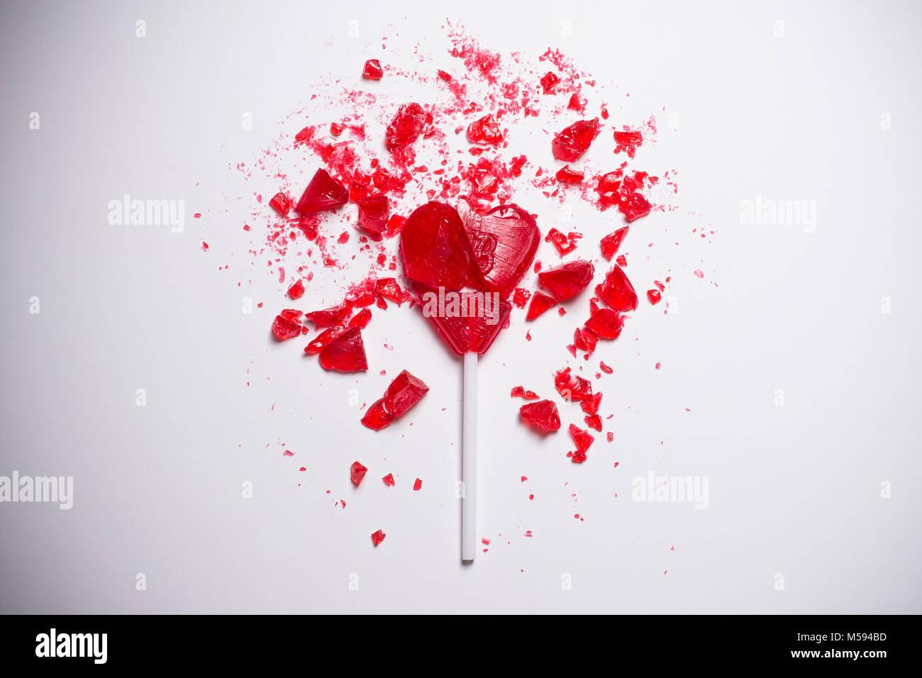 broken heart shaped lollipop - Stock Image
