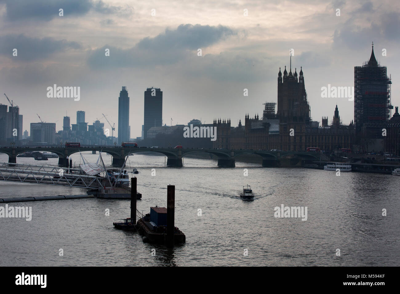 View westwards towards Houses of Parliament along the River Thames from Waterloo Bridge, London, United Kingdom - Stock Image