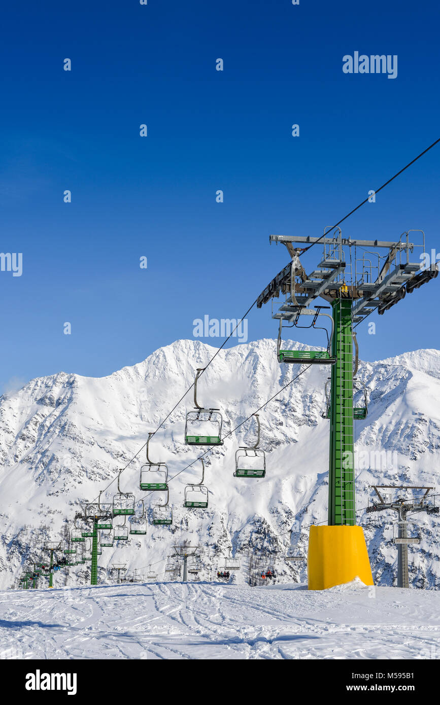 Chairlift at snow covered Italian ski area in the Alps - winter sports concept with copy space Stock Photo