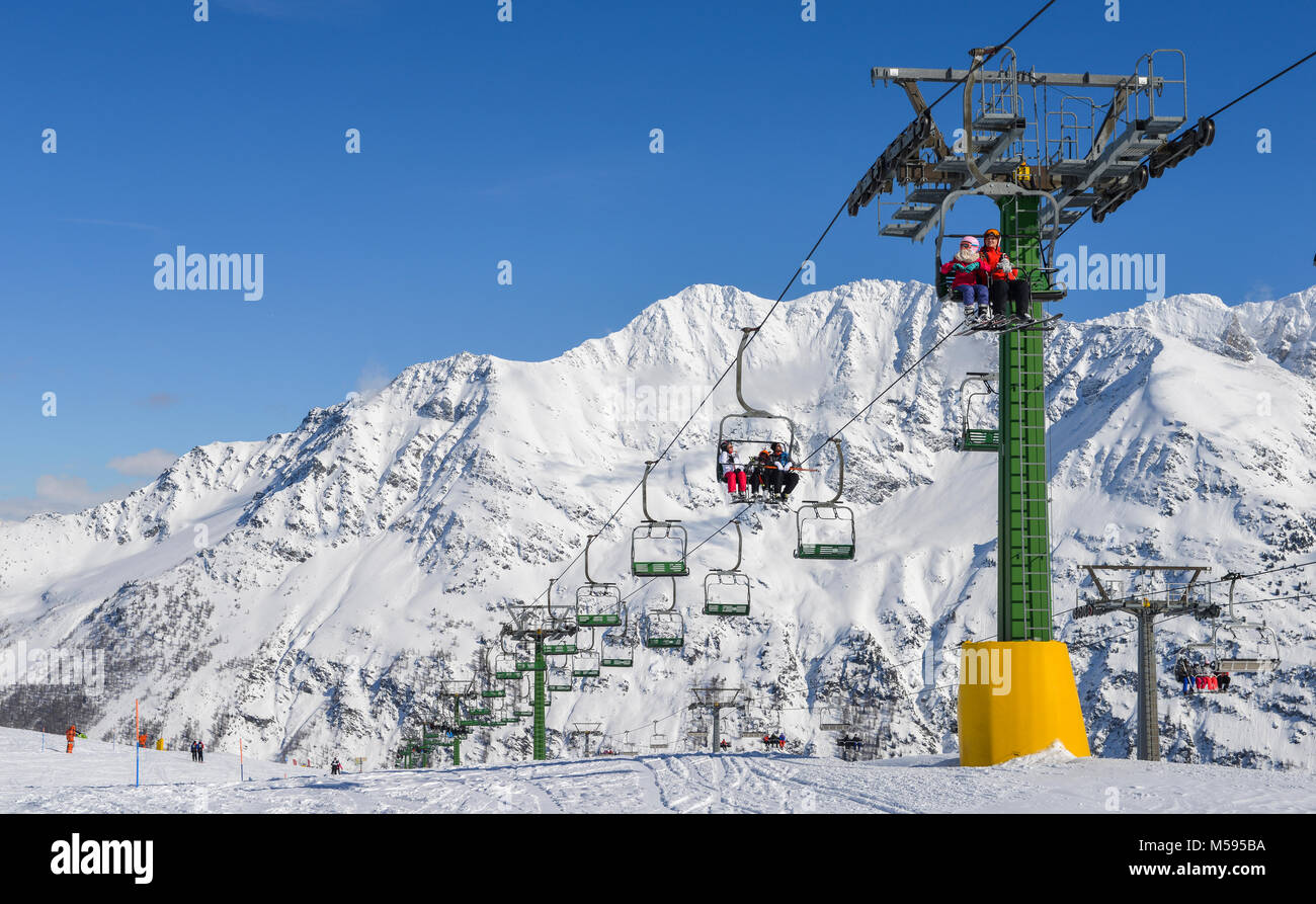 La Thuile, Italy - Feb 18, 2018: Chairlift at snow covered Italian ski area in the Alps - winter sports concept Stock Photo