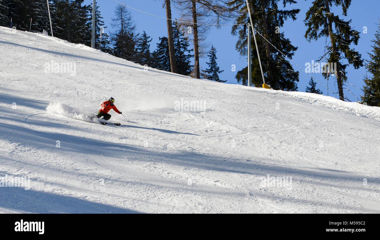 La Thuile, Italy - Feb 18, 2018: Sole skier down a piste at high speed - Stock Image