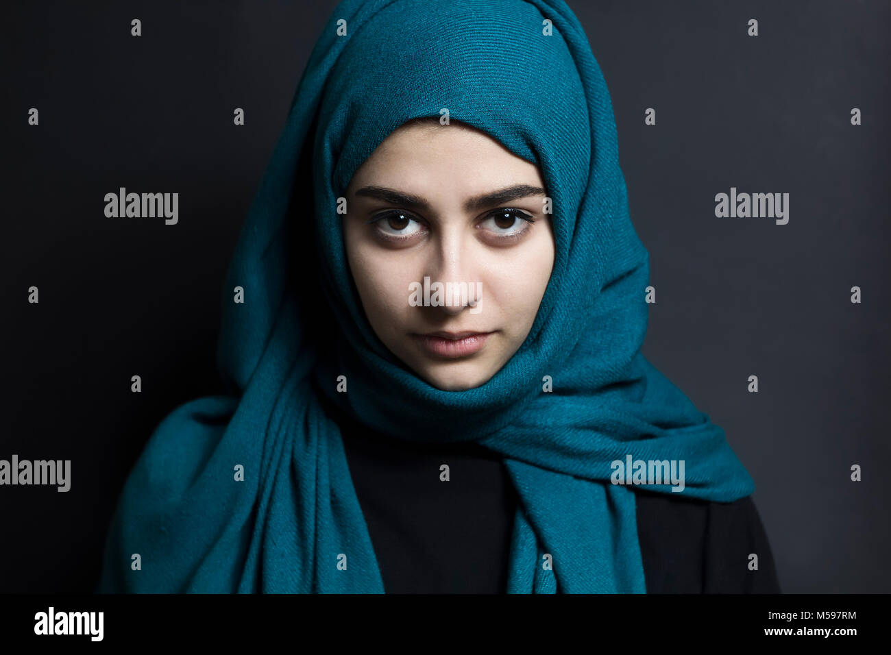 A beautiful muslim girl with eyes on a black background arab woman with beautiful eyes