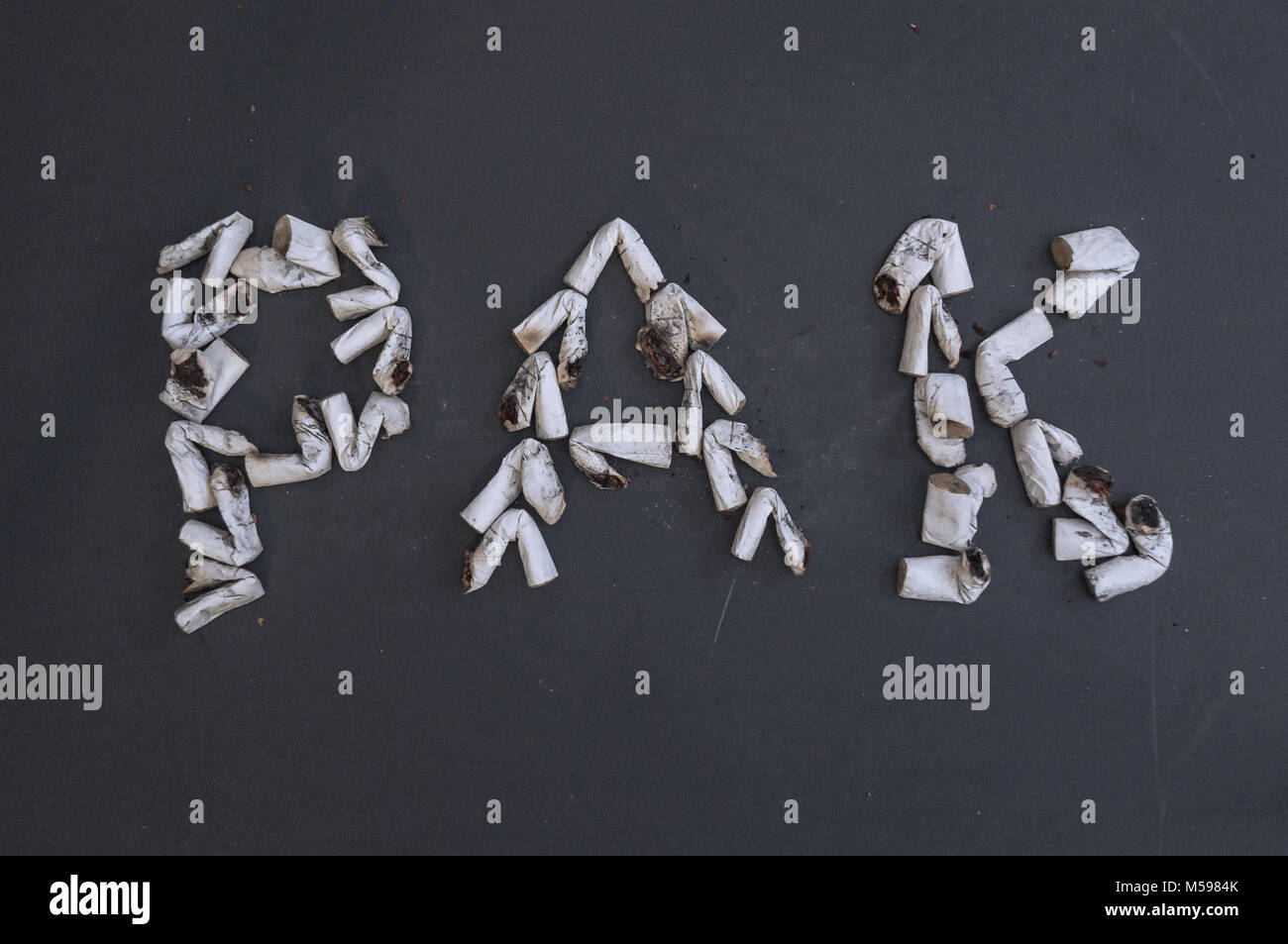 Rak is a Russian name for a canister made from cigarette butts to visualize the harm of smoking. Against smoking - Stock Image