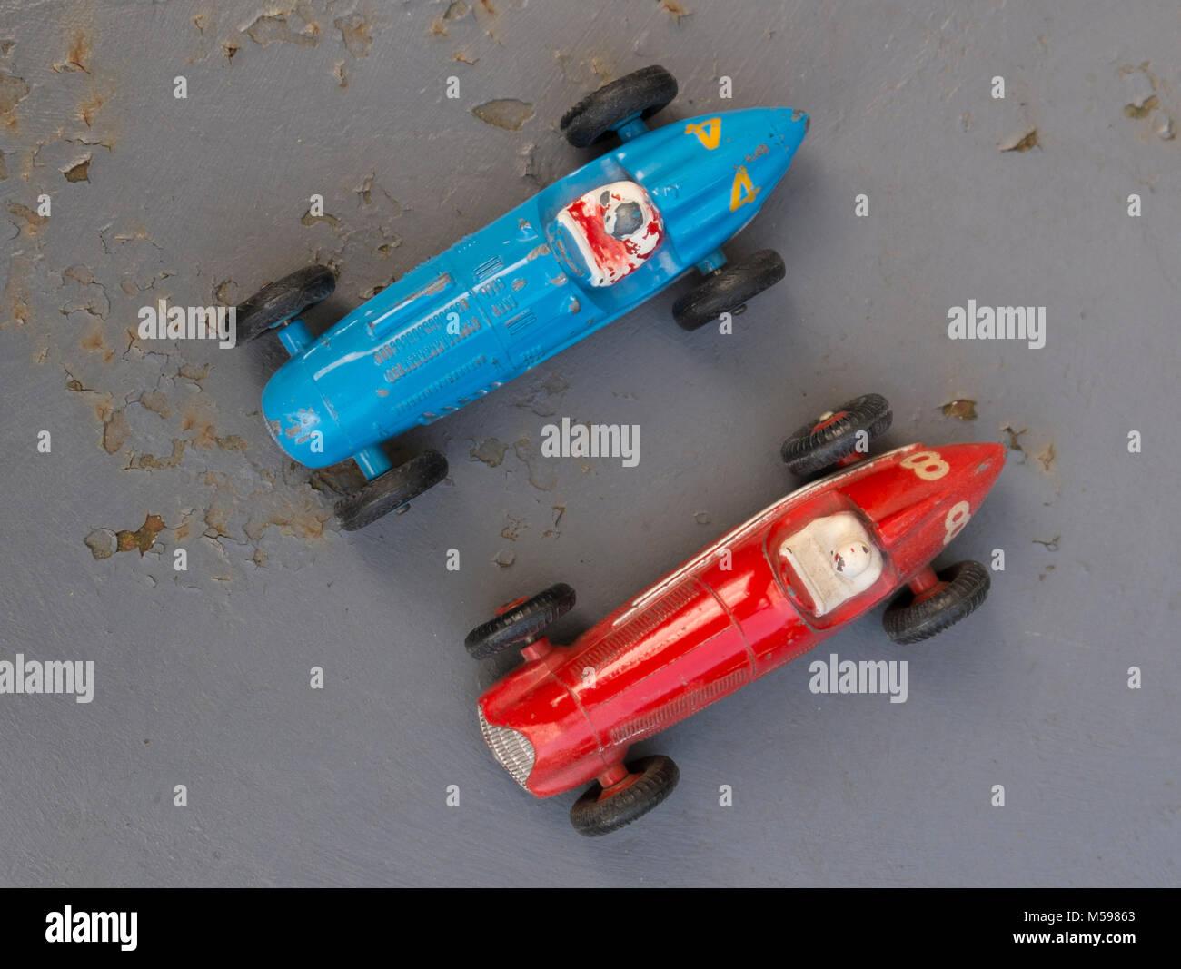 Talbot Lago and Alfa Romeo vintage Dinky toys on an old rusty metal garden table Stock Photo